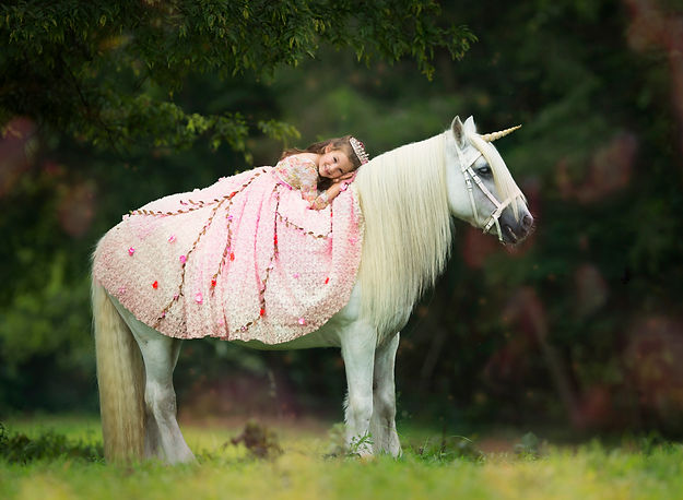 Laying on the horse after copy.jpg