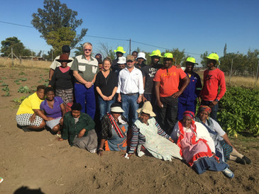 Canaf CEO with Community Garden Project, Supported by Southern Coal
