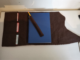 A5 leather notebook holders with spell card slots and pencils