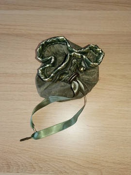 Faux seude lined dice bag.