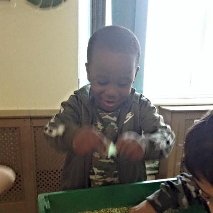 child playing sensory activity.jpg