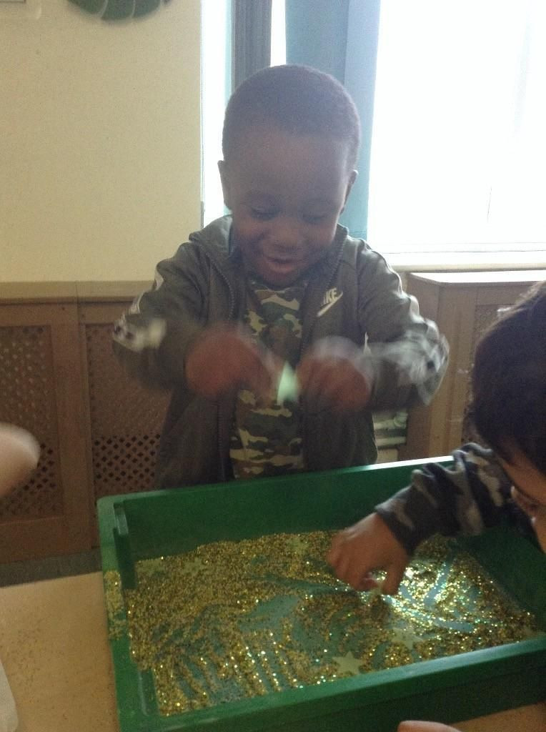 child playing sensory activity.jpg