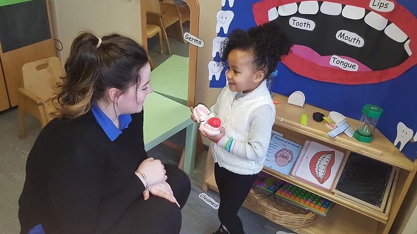 Child learning with key person at this fantastic Manchester nursery