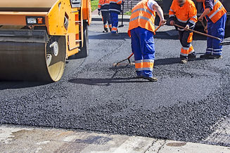 Roller and workers on asphalting and rep