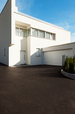 modern house white with garage , view fr