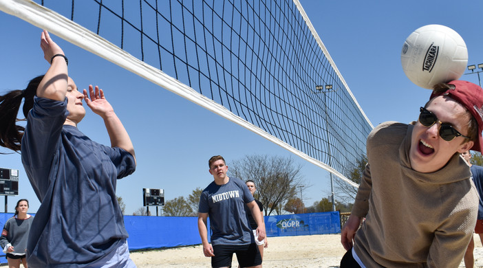 WKU student George Stice takes a volleyball to the head on Saturday, April 3, 2021 at Preston Miller Park. Stice and friends celebrated the warm weather playing sand volleyball.