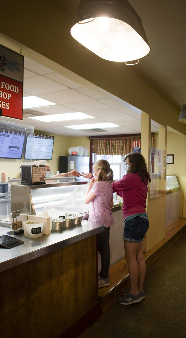 Two Chaney's customers order ice cream on Tuesday, April 20, 2021.
