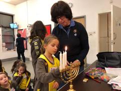 Brownies lighting the menorah