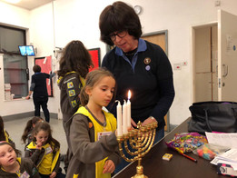 Brownies lighting the menorah