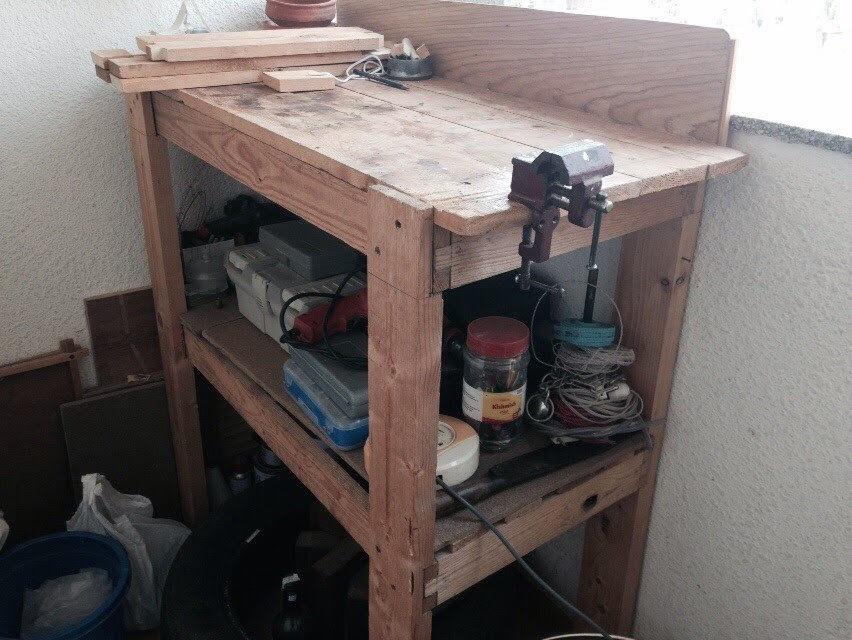 Simple Home Workshop Table, placed in a balcony