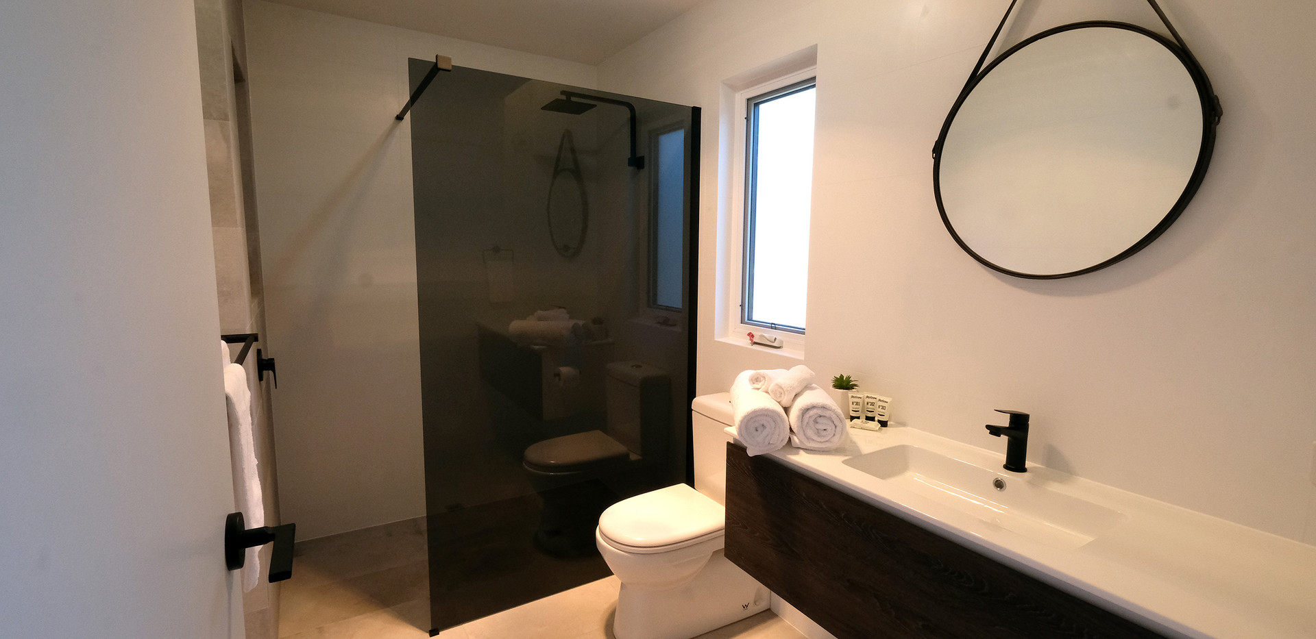 Bathroom with smoked-glass, oversized shower & WC