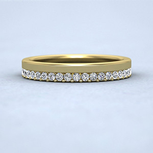 Yellow gold assemetric design diamond set ring.