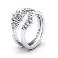 Platinum three stone engagement ring and matching wedding ring.