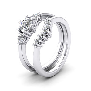 Platinum three stone engagement ring and matching wedding ring.