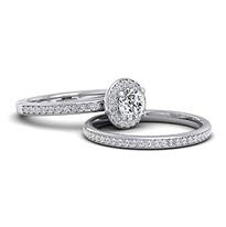Halo design diamond engagement ring with matching wedding ring.