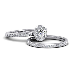 Halo design diamond engagement ring with matching wedding ring.