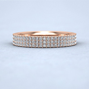 Rose gold bead set diamond ring with three rows.