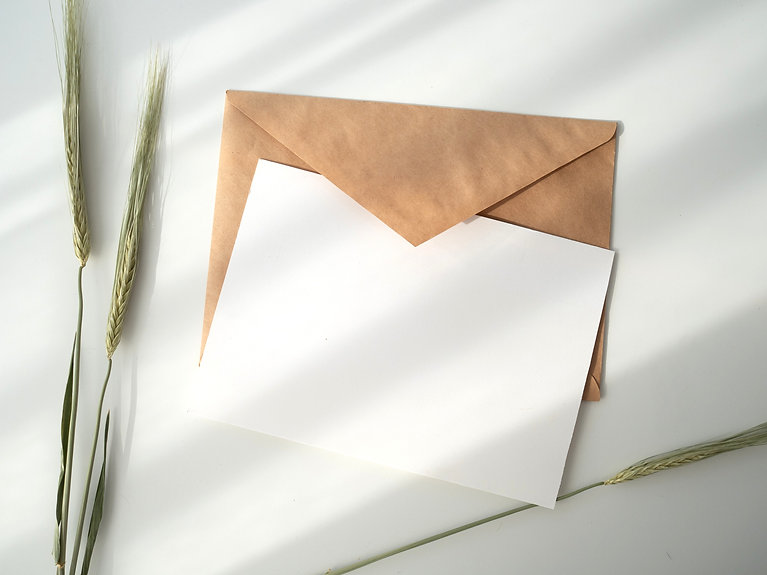 white%20paper%20and%20brown%20envelope_edited.jpg