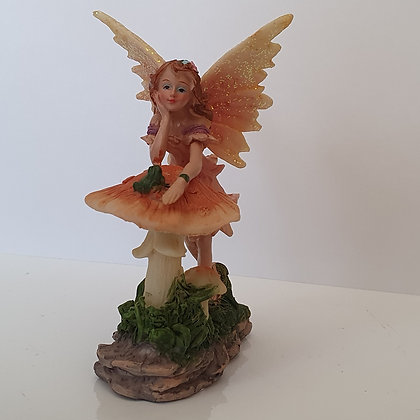 Flower Fairy Leaning on a Toadstool Ornament
