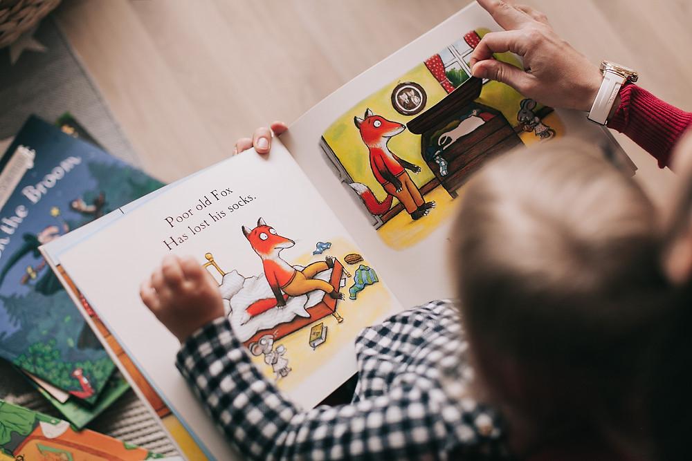 Child Reading Photo by Lina Kivaka from Pexels