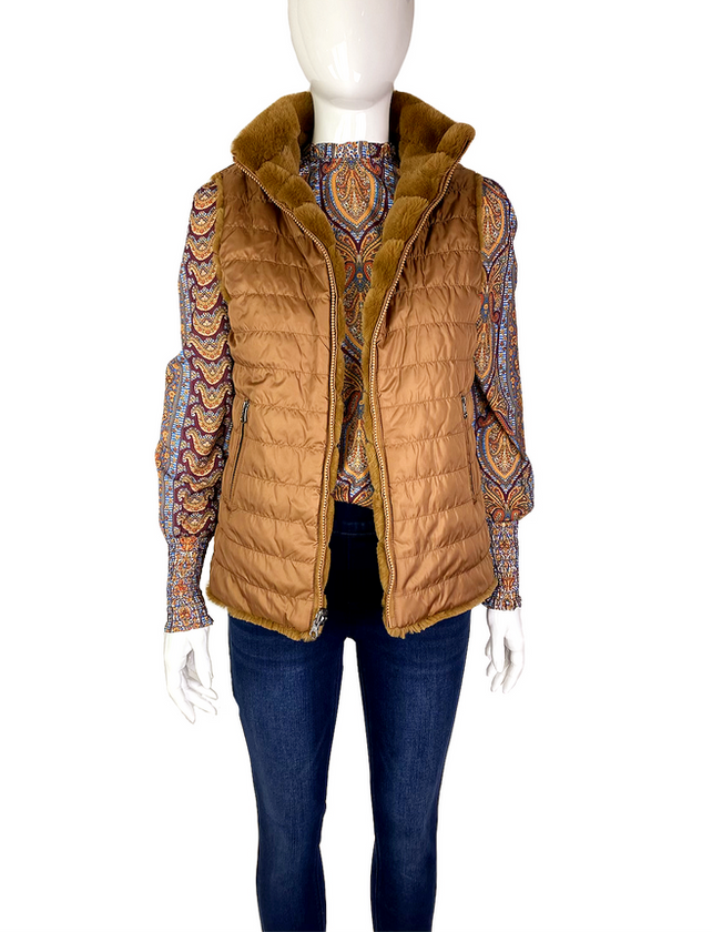 THIS REVERSIBLE VEST IS 100%