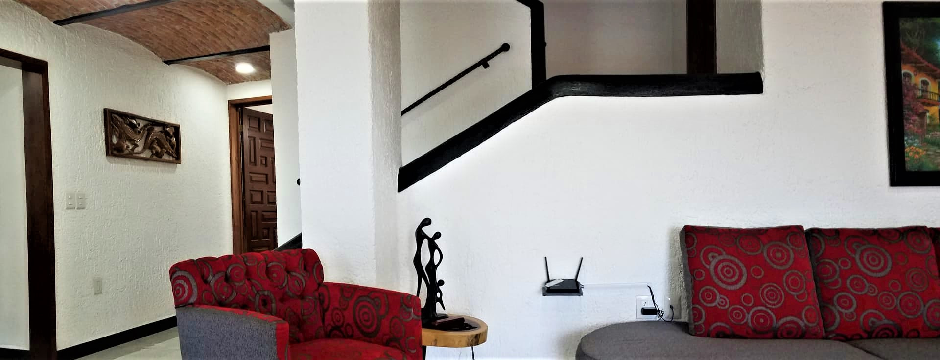 Living room with stairs view.jpg
