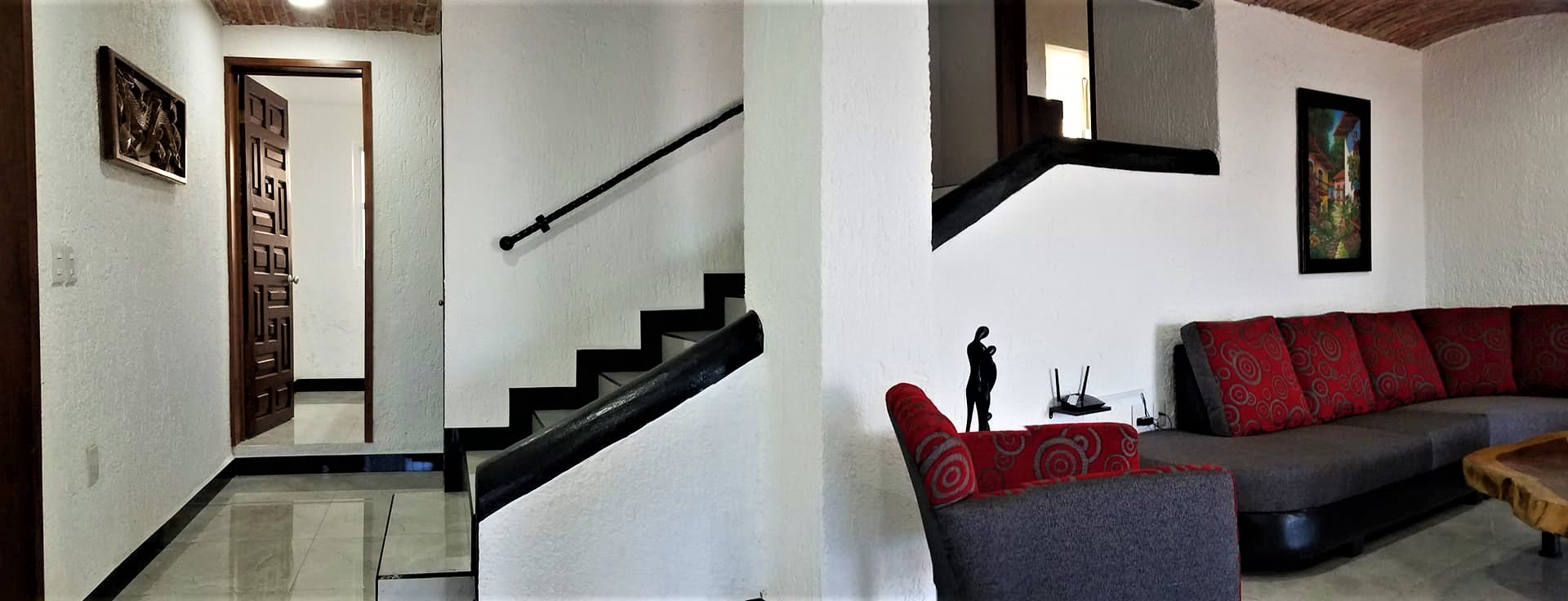 Living room with stairs view (2).jpg
