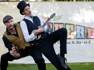 A Comedy street show with two guys doing acrobatics whilst playing ukuleles & singing!