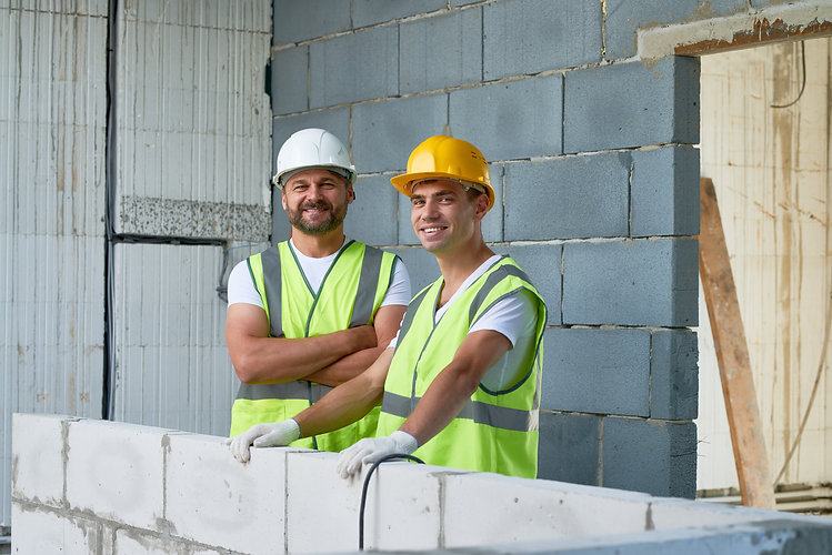 portrait-of-smiling-construction-workers-2021-04-02-23-19-08-utc.jpg