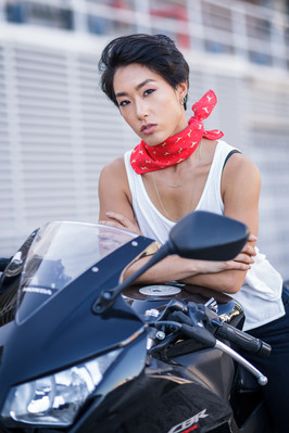 Red scarf Asian woman on motorbike