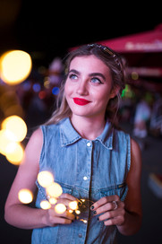 makeup red lip holding fairy lights