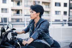 Asian Woman on Motorbike