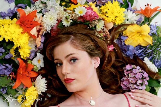 Woman girl lying on flowers