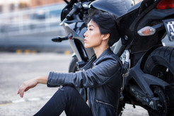 woman with motorbike leaning