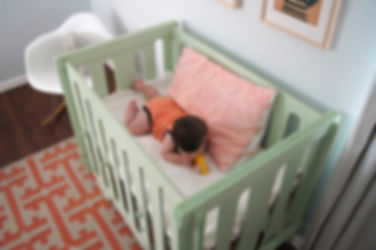 BABY IN CRIB.jpeg