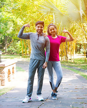 indian-asian-young-couple-jogging-running-exercising-stretching-outdoors-park-nature(1).jp