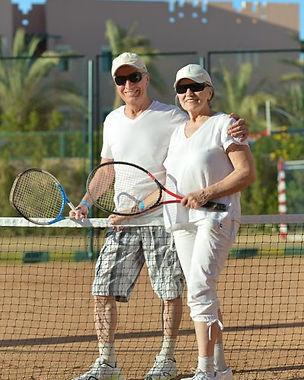 depositphotos_42392353-stock-photo-senior-couple-playing-tennis.jpg