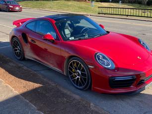 Prayer, Ice, Steep Ledge and a Red Porsche