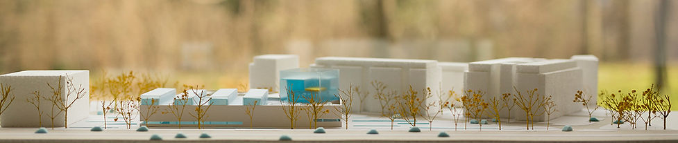 scale model of swimming pool building in relationship with city avenue
