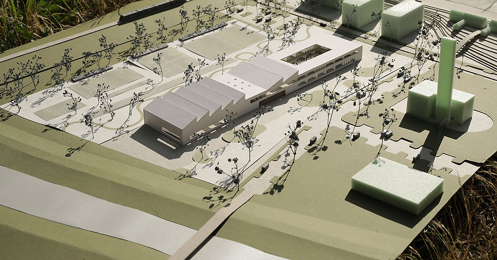 Scale model of school building and public square
