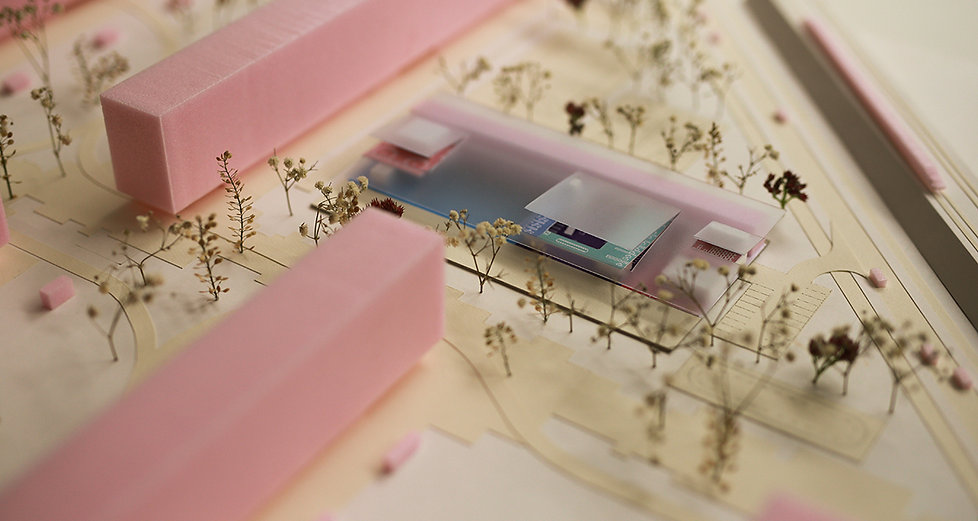 Scale model of school buildng with translucent roof overlooking the green park