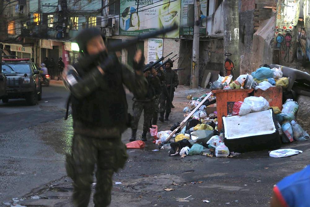 Brazilian military entering Rio de Janeiro's Rocinha Favela to combat armed drug traffickers