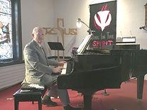 tom at piano.JPG