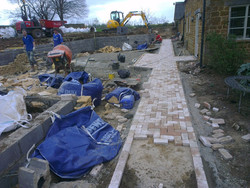 Clay brick path going being installed
