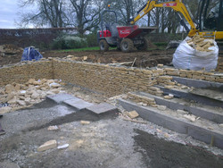 Dry stone step risers incorporated into walling bond