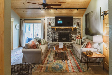 Living room with stone fireplace and gorgeous mantle