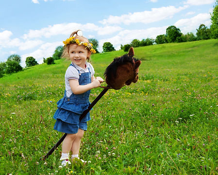 girl with stick horse