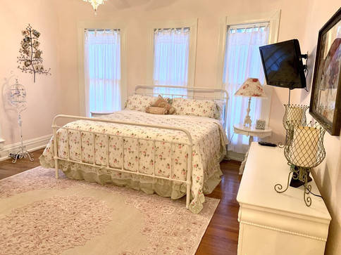 """The Rose Room"" - master bedroom with king bed"