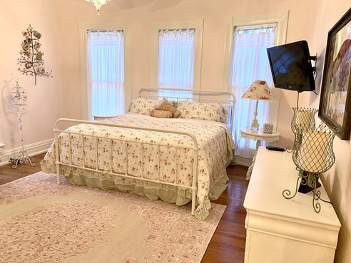 """""""The Rose Room"""" - master bedroom with king bed"""