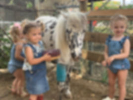 little girls with hustler FB tinypng.jpg